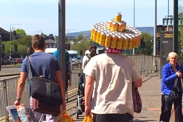 Man in Glasgow snapped wearing Tennent's lager can sombrero