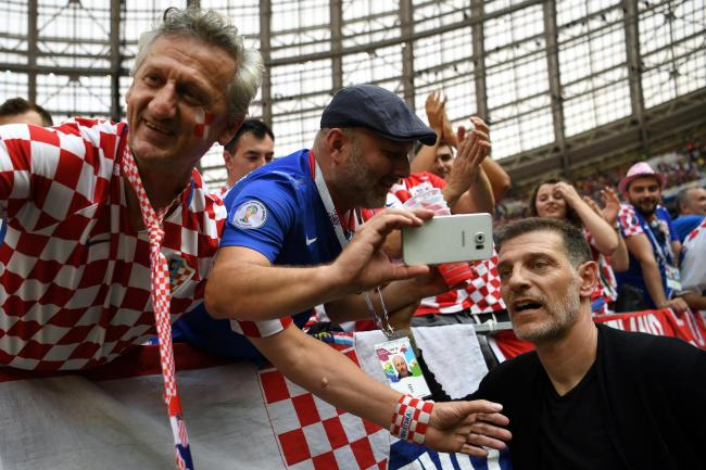 Slaven Bilic poses with supporters at the 2018 World Cup