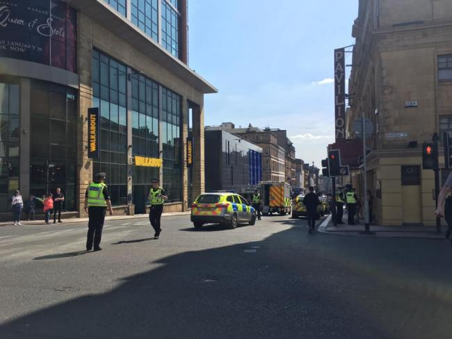 Emergency services rush to city centre street after woman 'hit by car'