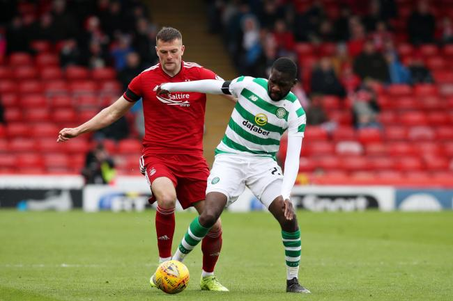 ABERDEEN, SCOTLAND - MAY 04: Odsonne Edouard of Celtic is challenged by Michael Devlin of Aberdeen during the Ladbrokes Scottish Premiership match between Aberdeen and Celtic at Pittodrie Stadium on May 04, 2019 in Aberdeen, Scotland. (Photo by Ian MacNic