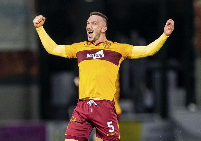 10be2d4e Tom Aldred laps up the celebrations as his double gave Motherwell victory  over Hamilton.