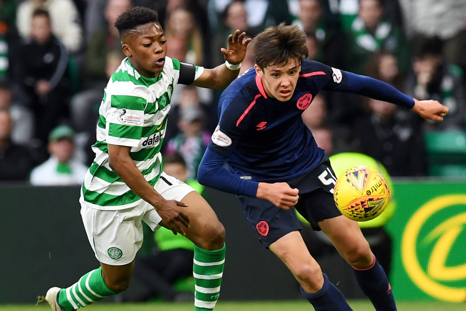 Celtic 2 Hearts 1: Karamoko Dembele makes his debut aged just 16 as Mikey Johnston double clinches victory