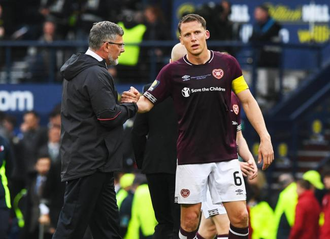 Hearts manager Craig Levein, left, and his captain Christophe Berra after the defeat to Celtic.