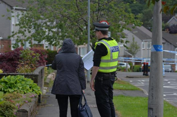 Evening Times: Residents were escorted to and from the area. (Kirsty Anderson/Herald and Times)