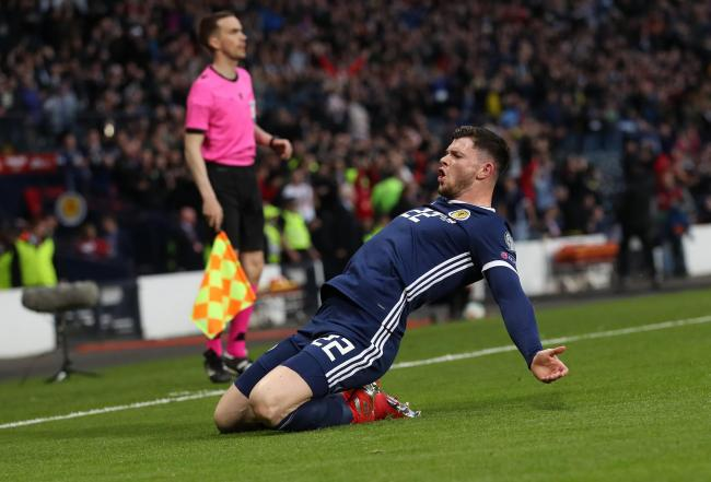 Oliver Burke celebrates scoring for Scotland. Photo by Ian MacNicol/Getty Images.