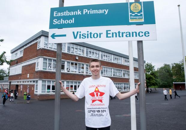 Evening Times: John outside Eastbank primary.