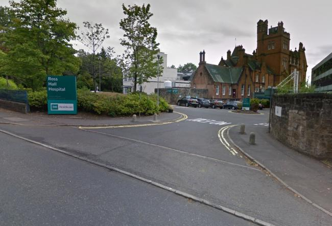 Woman cut from car after smash outside Ross Hall Hospital