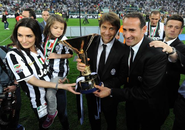 Juventus head coach Antonio Conte, second right, and assistant coach Angelo Alessio, right, celebrate Juventus's third consecutive Serie A win in 2013. Picture: Valerio Pennicino/Getty Images.