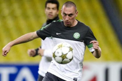 Celtic's Scott Brown gets on the ball during training at the Luzhniki Stadium in Moscow