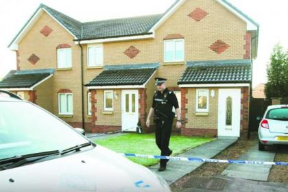 n Police cordoned off the house in Murray Crescent where two bodies were discovered by a mother. Picture: Colin Templeton