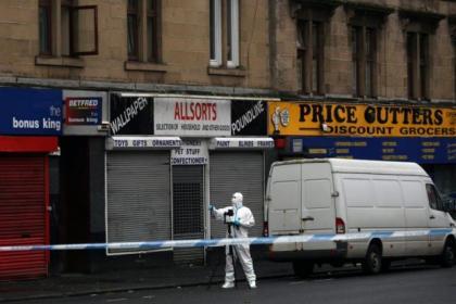 Police cordon off the area around the flat on Shettleston Road