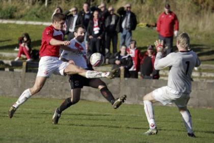 Glenafton defender Michael Williams gives protection to his goalkeeper Ally Semple by ensuring Clydebank's Joe Andrew was foiled on this occasion