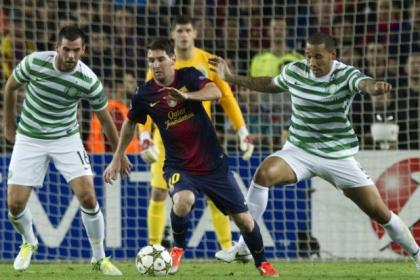 Kelvin Wilson keeps a close watch on Lionel Messi