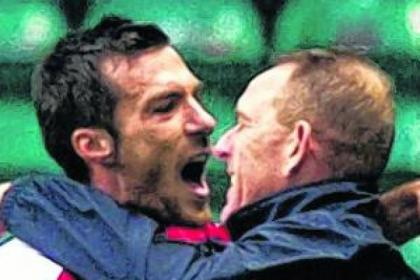 Kilmarnock's Manuel Pascali celebrates victory over Celtic with boss Kenny Shiels
