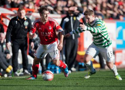 Aberdeen's Niall McGinn tries to get by Celtic's Kris Commons