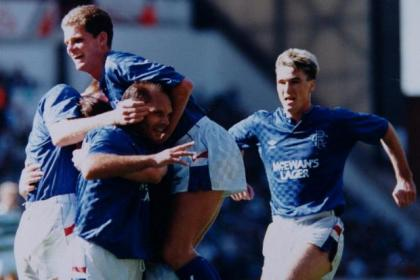 Ray Wilkins is congratulted by Ian Durrant and Ian Ferguson after scoring in Rangers' 5-1 win over Celtic at Ibrox in 1988