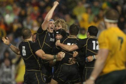 Al Kellock raises his arm in celebration after Scotland's famous win over Australia in June