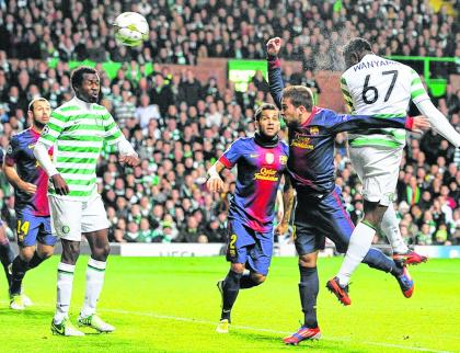 Victor Wanyama rises above the Barca defence to head home Celtic's opening goal