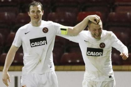 Dundee United's Johnny Russell, right, celebrates his goal with team-mate Jon Daly
