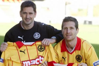 Jackie McNamara and Hugh Murray with the new yellow and red strips Partick Thistle will wear against Dunfermline