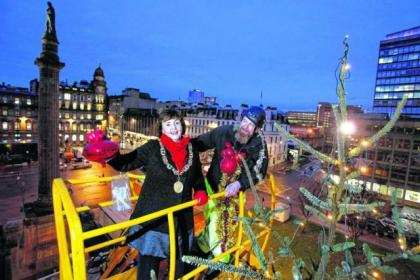 Lord Provost Sadie Docherty adds the final touch to the George Square Christmas tree