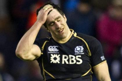 Scotland captain Kelly Brown is dejected at full time on Saturday