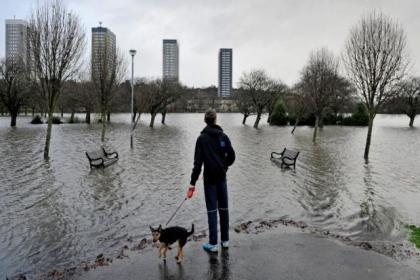 Walking the dog in the park is called off after the White Cart Water inundated the King George V playing fields in Thornliebank. Picture: Nick Ponty