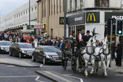 Caden's coffin was carried through the streets on a horse-drawn carriage