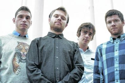 The lads are putting a year of globetrotting behind them with Glasgow gig