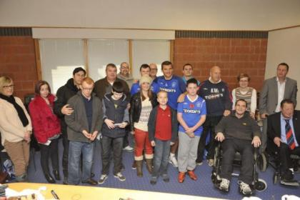 Lee McCulloch and Kenny McDowall with a very special group of Rangers fans at Murray Park.  Picture: Jamie Simpson