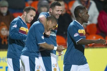 Goal heroes Michael Higdon and Chris Humphrey, both centre, celebrate after the latter fired the Steelmen into a two-goal lead at Tannadice