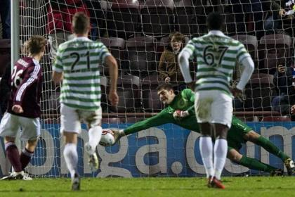Fraser Forster gets down well to save a late penalty from Hearts skipper Marius Zaliukas