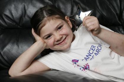 Sarah McGinnes shows off her Litte Star award