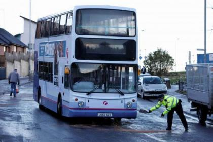 Police grit Kinfauns Drive in Drumchapel to get buses moving today following the crash