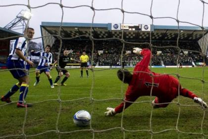 Scott Brown fires past keeper Cammy Bell to open the scoring for Celtic