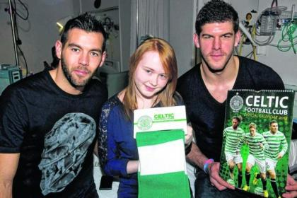 n Celtic players Joe Ledley, left and Fraser Forster meet Kate McFadden as the first team stars tour the wards with gifts to cheer up the children n Team captain Scott Brown, left, chats with little Aaron Dunn while, right, Eilidh Higgins is in the safe hands of Tony Watt as Victor Wanyama looks on n Celtic players Lassad Nouioui, Kelvin Wilson and Beram Kayal meet Claire McKenzie and her baby Paige Celtic players Joe Ledley, left and Fraser Forster meet Kate McFadden as the first team stars tour the wards with gifts to cheer up the children