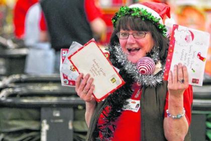 Marie Dougan working hard at sorting Christmas post