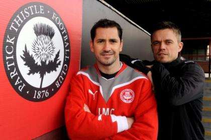 Jackie McNamara is joined by assistant Simon Donnelly after signing his new deal with the Firhill club