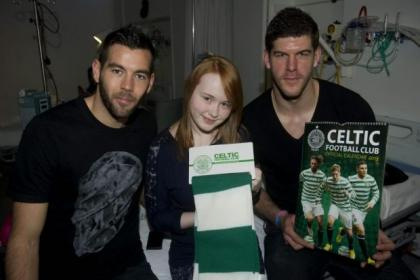 Celtic players Joe Ledley, left, and Fraser Forster, right, met Kate McFadden when club stars visited Glasgow's Yorkhill Hospital for Sick Children last week to hand out gifts