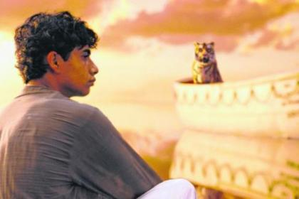Suraj Sharma stars as Pi Patel, who finds himself adrift in a lifeboat with a Bengal tiger