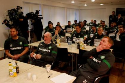 All roads point to Turin... Neil Lennon and his squad watch the draw at Lennoxtown this morning