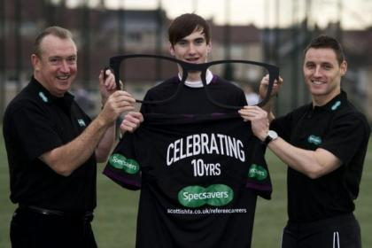Here's looking at you kid...SFA referee observer Willie Young, left, and education manager Steven McLean, right, take delivery of the lastest must-have Christmas present for the men in black