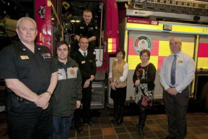 From left, group commander Edward Mullen; Derek Watson of Community Trust (Motherwell Football Club); Mick Hydes, commander safety coordinating; John Joyce, area commander (in cab); Sandra Shafii, AHP dementia training; Arlene Crockett, NHS liaison officer, and Pete Gilfedder, NHS liaison officer, are all involved in dementia training scheme