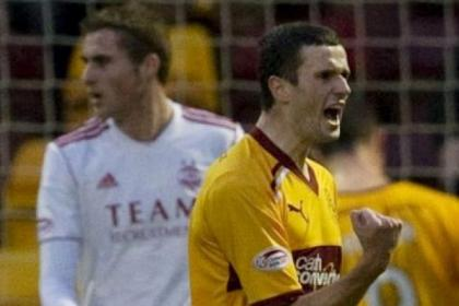 Jamie Murphy celebrates his double