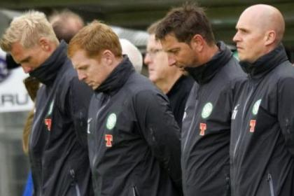 A poignant moment as Johan Mjallby, Neil Lennon, Garry Parker and Tim Williamson observe a minute's silence in Germany in tribute to former Celtic hero Joe McBride, who died last week