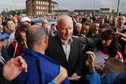 John Brown is mobbed by fans outside Ibrox