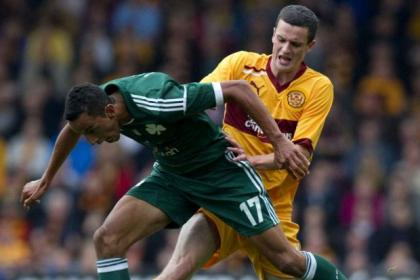 Motherwell's Jamie Murphy tackles Zeca of Panathinaikos
