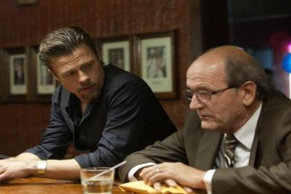 Brad Pitt as a hitman, and Richard Jenkins as the man who discusses plans and payments  Brad Pitt as a hitman, and Richard Jenkins as the man who discusses plans and payments