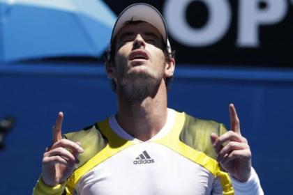 Andy Murray celebrates after beating Dutchman Robin Haase in Melbourne today