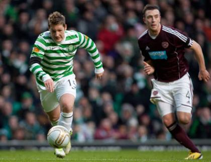 Kris Commons breaks by Hearts' Danny Wilson